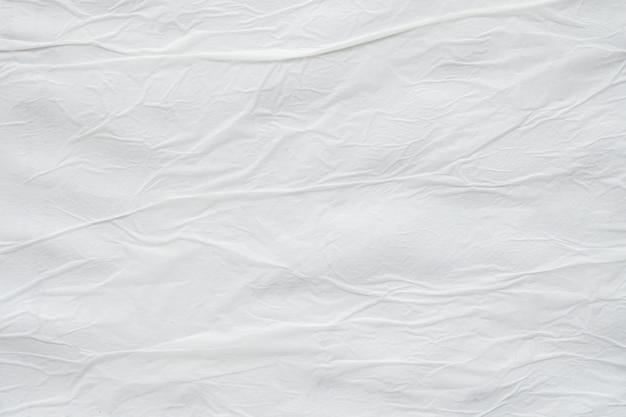Fondo de superficie de textura de cartel de papel rasgado arrugado arrugado blanco en blanco
