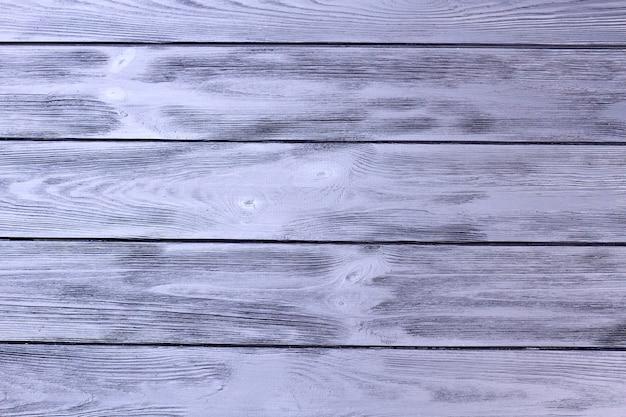 Fondo de superficie de textura de escritorio de madera gris viejo.