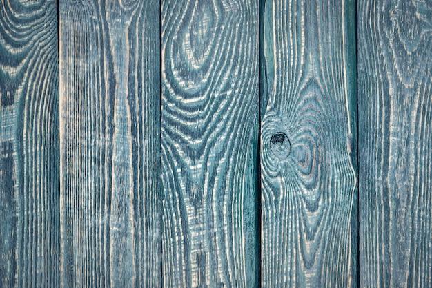 Fondo de tableros de madera de textura vintage con restos de pintura vieja. vertical.