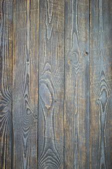 Fondo de tableros texturizados de madera natural con los rastros de pintura gris.