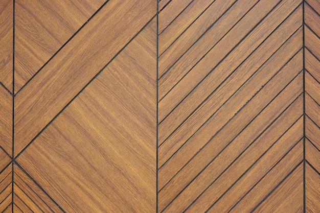 Fondo tallado madera marrón de la textura del modelo