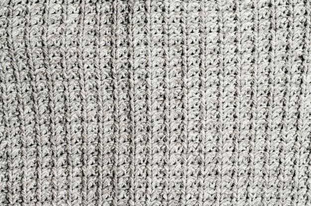 Fondo de tejido de punto gris