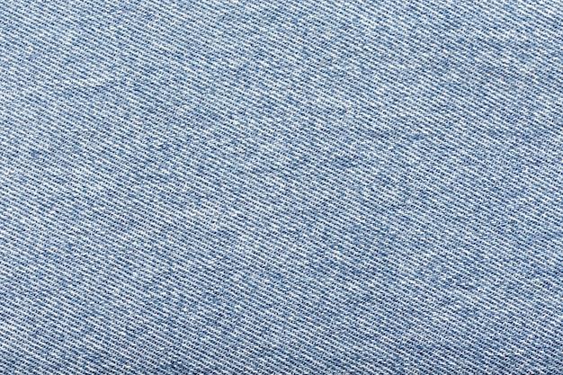 Fondo de tela de mezclilla azul claro.