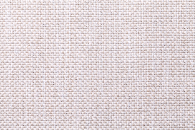 Fondo textil blanco y beige con el patrón a cuadros, primer plano. estructura de la macro de la tela.