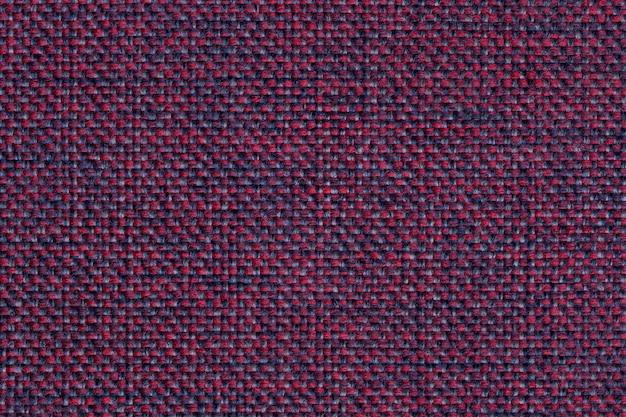 Fondo textil magenta con patrón a cuadros, primer plano, estructura de la macro de tela,