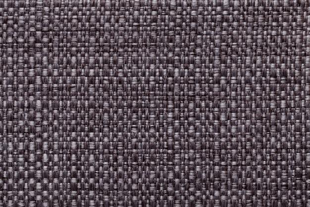 Fondo textil marrón con patrón de cuadros.