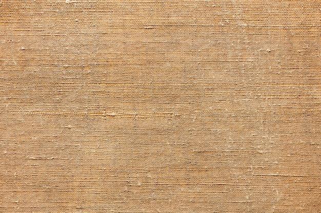 Fondo de textura abstracta de lienzo antiguo para pintar la vista superior de cerca