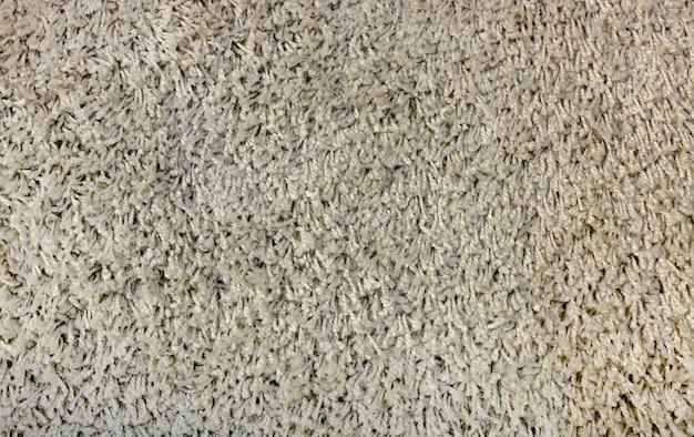 Fondo de la textura de la alfombra.