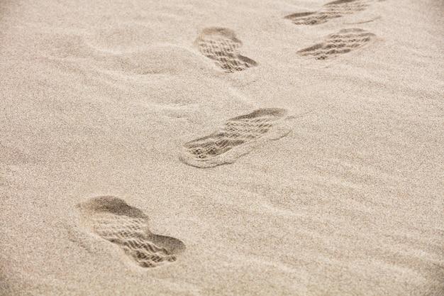 Fondo y textura de arena en una playa en verano