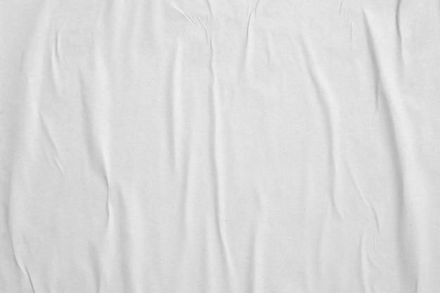 Fondo de textura de cartel de papel arrugado y arrugado blanco en blanco