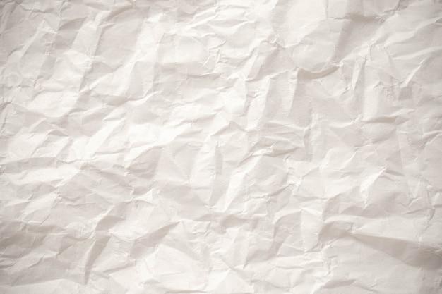 Fondo de textura de cerca de papel arrugado blanco