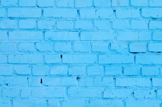 Fondo y textura cuadrados de la pared del bloque del ladrillo. pintado en azul