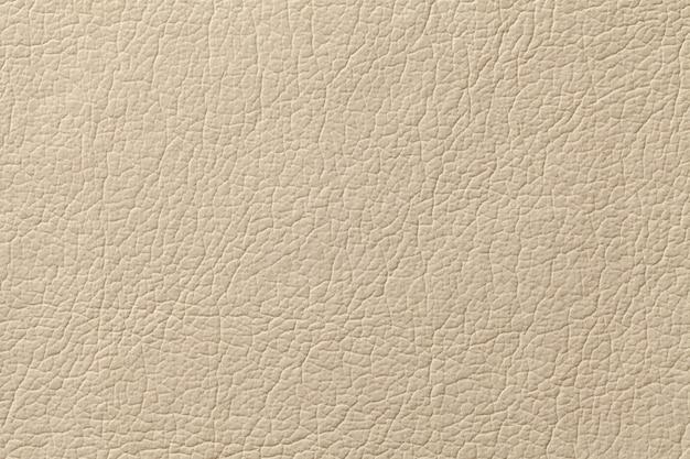 Fondo de textura de cuero beige claro con patrón, primer plano