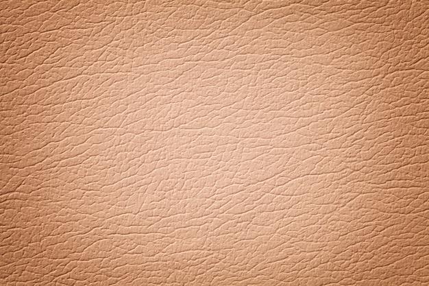 Fondo de textura de cuero marrón claro, primer plano.