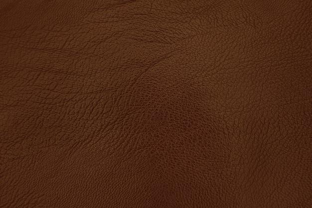 Fondo de textura de cuero marrón oscuro con superficie transparente y alta resolución.