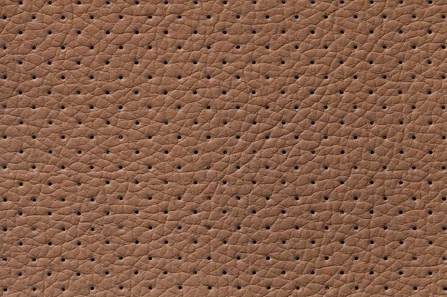 Fondo de textura de cuero marrón perforado