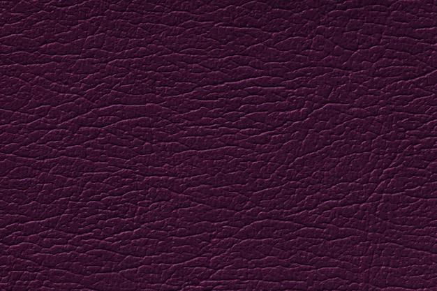 Fondo de textura de cuero púrpura oscuro con patrón, primer plano
