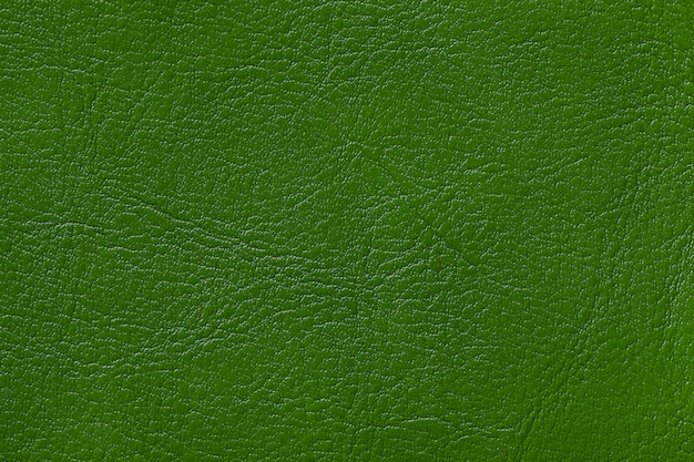 Fondo de textura de cuero verde oscuro, primer plano.