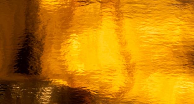 Fondo de textura dorada y efecto líquido