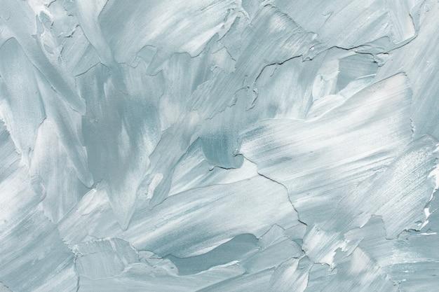 Fondo de textura de estuco o muro de hormigón rugoso azul claro y blanco abstracto