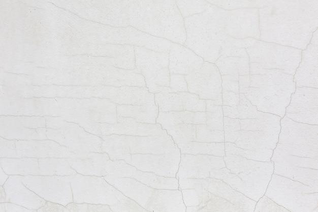 Fondo de textura de estuco de pared agrietada blanca