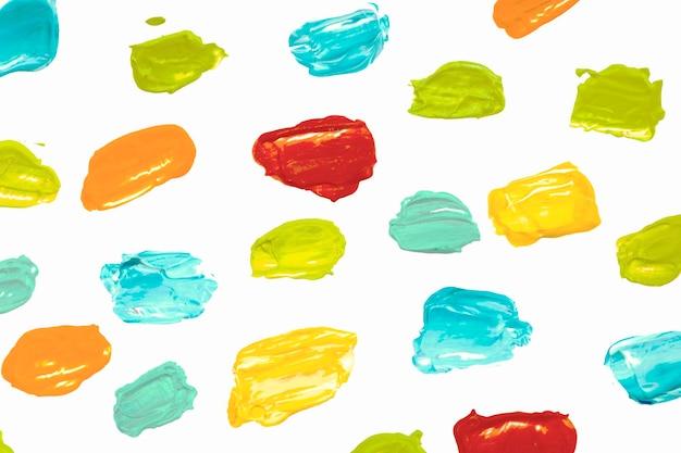 Fondo de textura de frotis de pintura en patrón de colores para niños