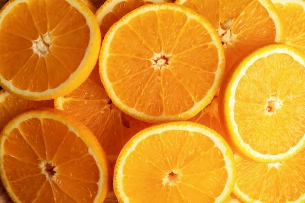 Fondo y textura de frutas naranjas en rodajas
