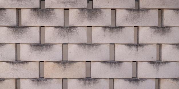 Fondo de textura gris de revestimiento de pared de bloque de hormigón de baldosas de hormigón