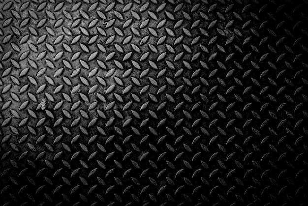 Fondo de textura de grungry antigua placa de diamante de metal degradado con arañazos y sucio en tono oscuro