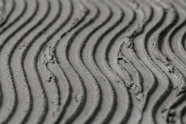 Fondo de textura de hormigón de patrón de onda gris