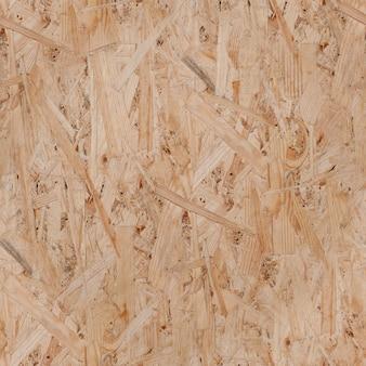 Fondo de textura de madera - aglomerado. patrón sin costuras