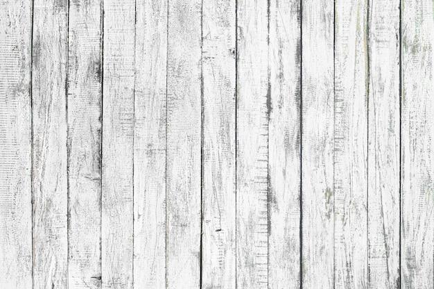 Fondo de textura de madera blanca procedente de árbol natural. paneles de madera viejos que son patrones vacíos y hermosos.
