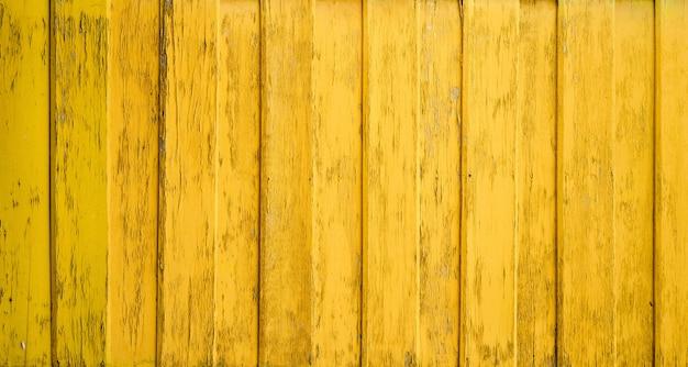 Fondo de textura de madera de pared amarilla