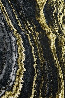 Fondo con textura de mármol en capas doradas y negras