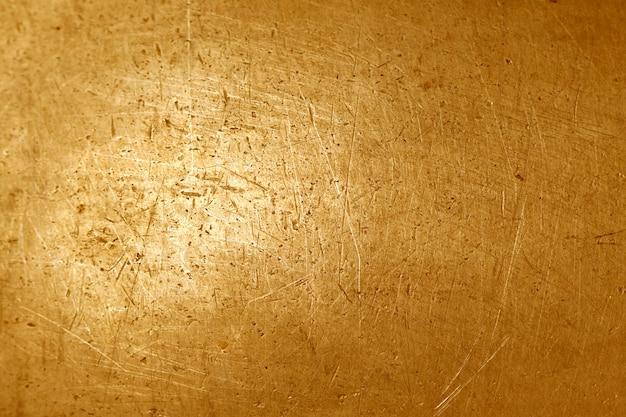Fondo de textura de metal dorado grunge