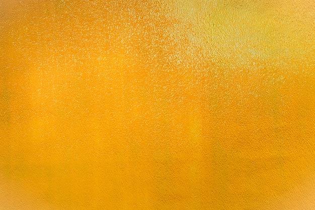Fondo de textura metálica dorada. telón de fondo amarillo dorado abstracto.