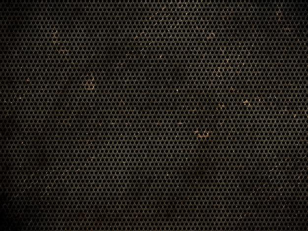 Fondo de textura metálica perforada de grunge