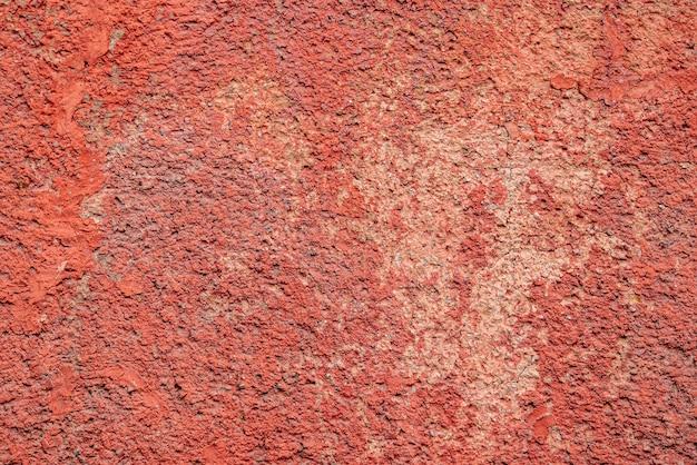 Fondo de textura de muro de hormigón rojo