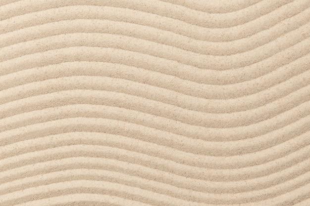 Fondo de textura de onda de arena zen en concepto de bienestar