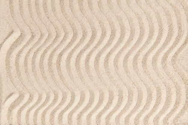 Fondo de textura de onda de arena zen en concepto de paz
