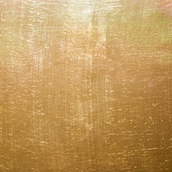 Fondo de textura de oro y rasguños