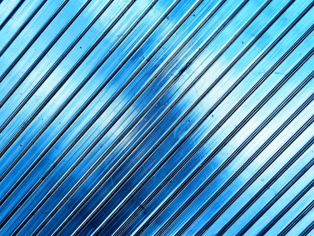 Fondo de textura de paneles transparentes azules diagonales