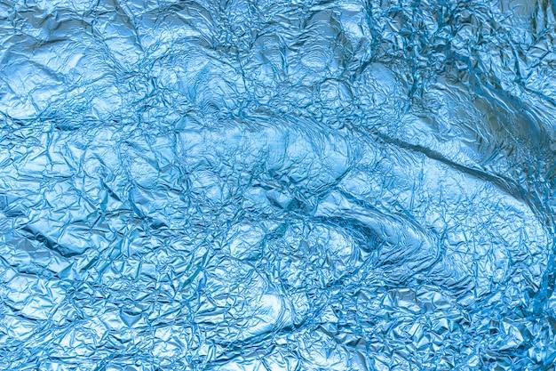 Fondo y textura de papel de aluminio azul