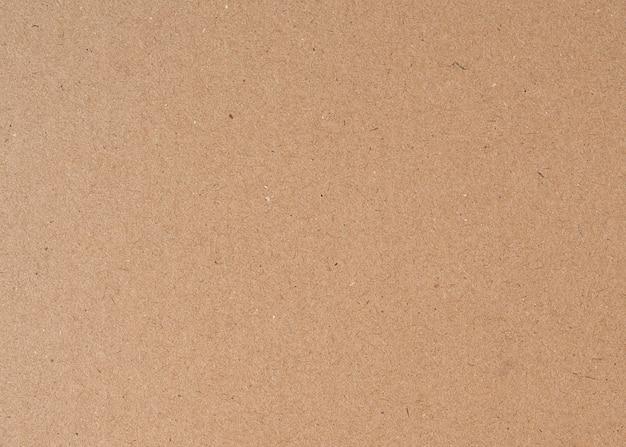 Fondo de textura de papel de cartón reciclado marrón antiguo de cerca