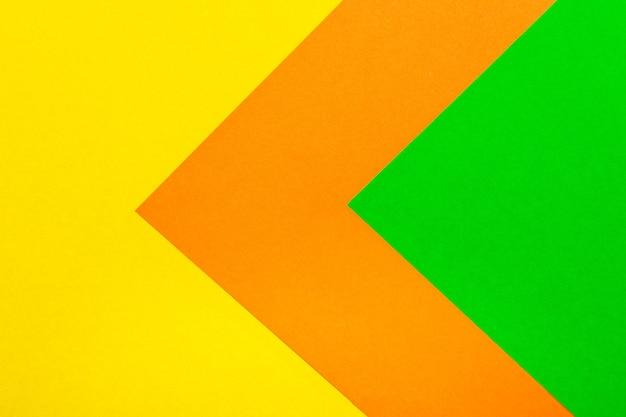 Fondo de textura de papel de color verde naranja y amarillo.