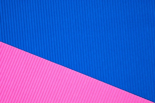 Fondo de textura de papel corrugado azul y rosa