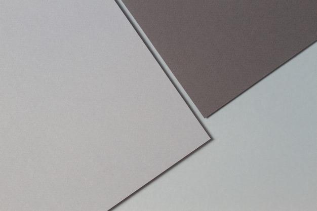 Fondo de textura de papel creativo monocromo gris abstracto. formas y líneas geométricas mínimas