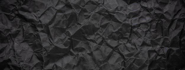 Fondo de textura de papel negro oscuro arrugado y arrugado