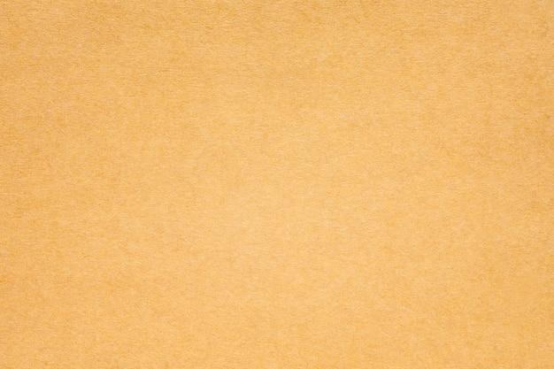 Fondo de textura de papel o cartón marrón.