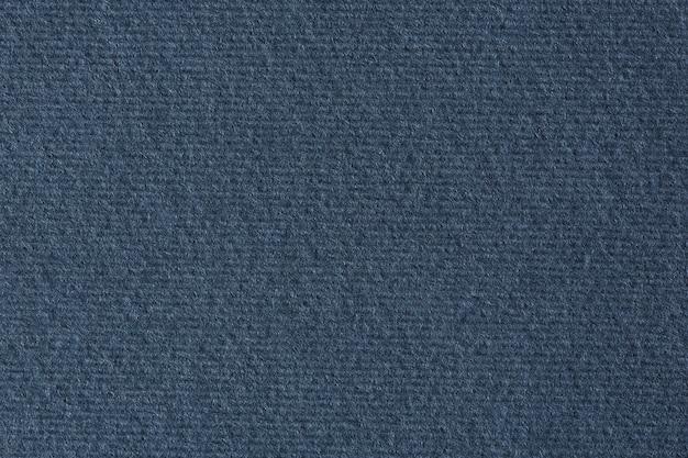Fondo de textura de papel rayado azul oscuro. fotografía macro.